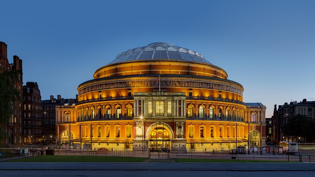 Exterior view of the Royal Albert Hall's North Entrance lit up at dusk